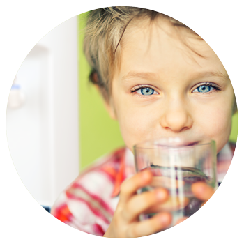 Kid drinking from XO water cooler