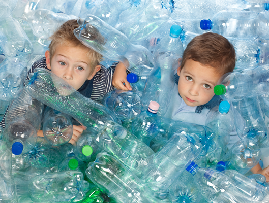 Kids in discarded bottles