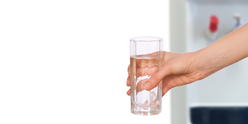 Drink of water from a bottleless water cooler